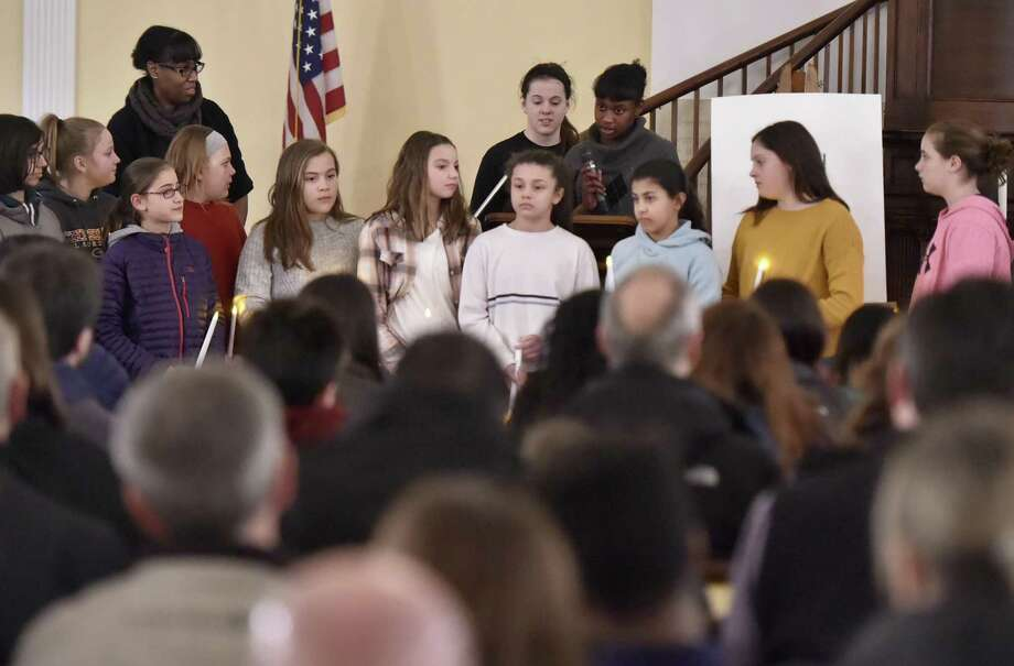 Friday, February 1, 2019: Doolittle School students pay their respects during a vigil in remembrance of 11-year-old Anjelita Estrada at the First Congregational Church of Cheshire. Photo: Peter Hvizdak / Hearst Connecticut Media / New Haven Register