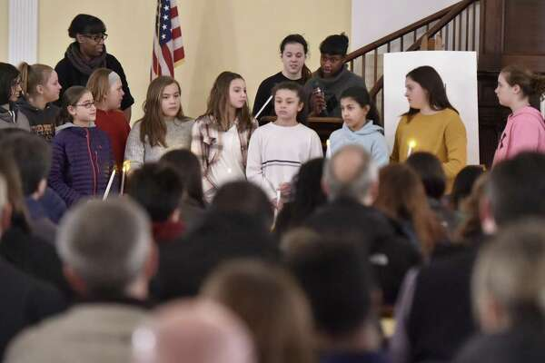 Friday, February 1, 2019: Doolittle School students pay their respects during a vigil in remembrance of 11-year-old Anjelita Estrada at the First Congregational Church of Cheshire.