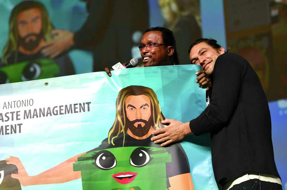 Actor Jason Momoa, who plays Aquaman in DC superhero films, is recognized for his support of recycling by David McCary, director of the City of San Antonio's Solid Waste Management Department, during Celebrity Fan Fest on Saturday, June 15, 2019. Marvel and DC Comics movie stars are scheduled to appear throughout the three-day event at Freeman Coliseum and Expos Halls. Photo: Billy Calzada, Staff Photographer / Billy Calzada