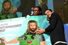 Actor Jason Momoa, who plays Aquaman in DC superhero films, is recognized for his support of recycling by David McCary, director of the City of San Antonio's Solid Waste Management Department, during Celebrity Fan Fest on Saturday, June 15, 2019. Marvel and DC Comics movie stars are scheduled to appear throughout the three-day event at Freeman Coliseum and Expos Halls.