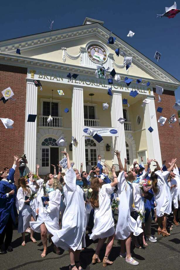 The graduates throw their caps in the air after the Shepaug Valley High School Class of 2019 Commencement, Saturday morning, June 15, 2019, on the Bryan Memorial Town Hall lawn, Washington, Conn. Photo: H John Voorhees III, Hearst Connecticut Media / The News-Times
