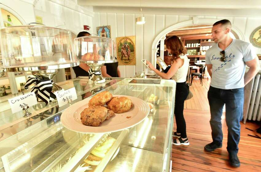 Old Saybrook, Connecticut - Saturday, June 15, 2019: Customers browse the Caffe Marche in Old Saybrook, located in the historic James Pharmacy Bed & Breakfast and Gelateria, whose baristas offer authentic Italian coffee, espressos, capuccinos, lattes, gourmet Connecticut coffees and cold brews, teas, local pastry and other repasts. Gelato is made fresh daily with natural italian products and fresh Farmer's Cow milk from Connecticut. Juices, smoothies, protein shakes, milk shakes and floats are also something to experience.
