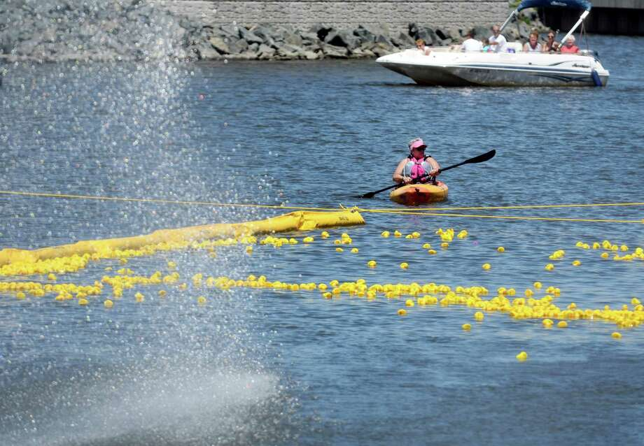 """Rubber ducks approached the finish line at the Fourth Annual Duck Derby for Autism and Guinness World Record Attempt on Saturday, June 15, 2019 at Mohawk Harbor in Schenectady, N.Y. 5000 ducks were """"adopted"""" by attendees to show support for individuals on the Autism spectrum and their families.(Catherine Rafferty/Times Union) Photo: Catherine Rafferty / 40047221A"""