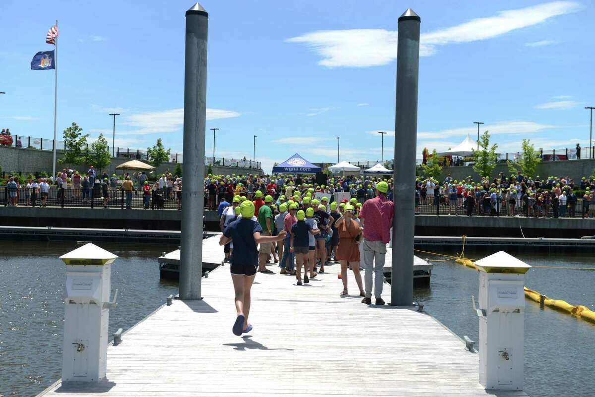 Attendees gather at Mohawk Harbor for the he Fourth Annual Duck Derby for Autism and Guinness World Record Attempt on Saturday, June 15, 2019 at Mohawk Harbor in Schenectady, N.Y. This year the Autism Society of Greater Capital Region partnered with the Adirondack Aquatic Center to attempt to beat the Guinness world record for largest gathering of people wearing swim caps. (Catherine Rafferty/Times Union)