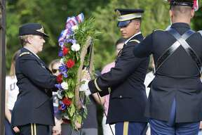 A wreath is placed by the gravesite of President George H.W. Bush and former First Lady Barbara Bush on Saturday, June 15, 2019 in College Station.