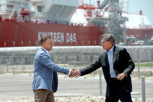 Polish President Andrzej Duda and U. S. Secretary of Energy Rick Perry shake hands following their joint press conference at Cheniere's Sabine Pass LNG facility, in Cameron Parish, LA, Friday. Photo taken Friday, June 14, 2019 Kim Brent/The Enterprise