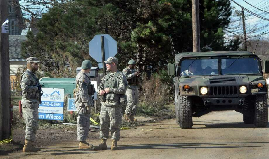 FILE PHOTO: The Connecticut Army National Guard monitors Cosey Beach Ave area in East Haven. Photo: Peter Hvizdak / New Haven Register / ©Peter Hvizdak /  New Haven Register