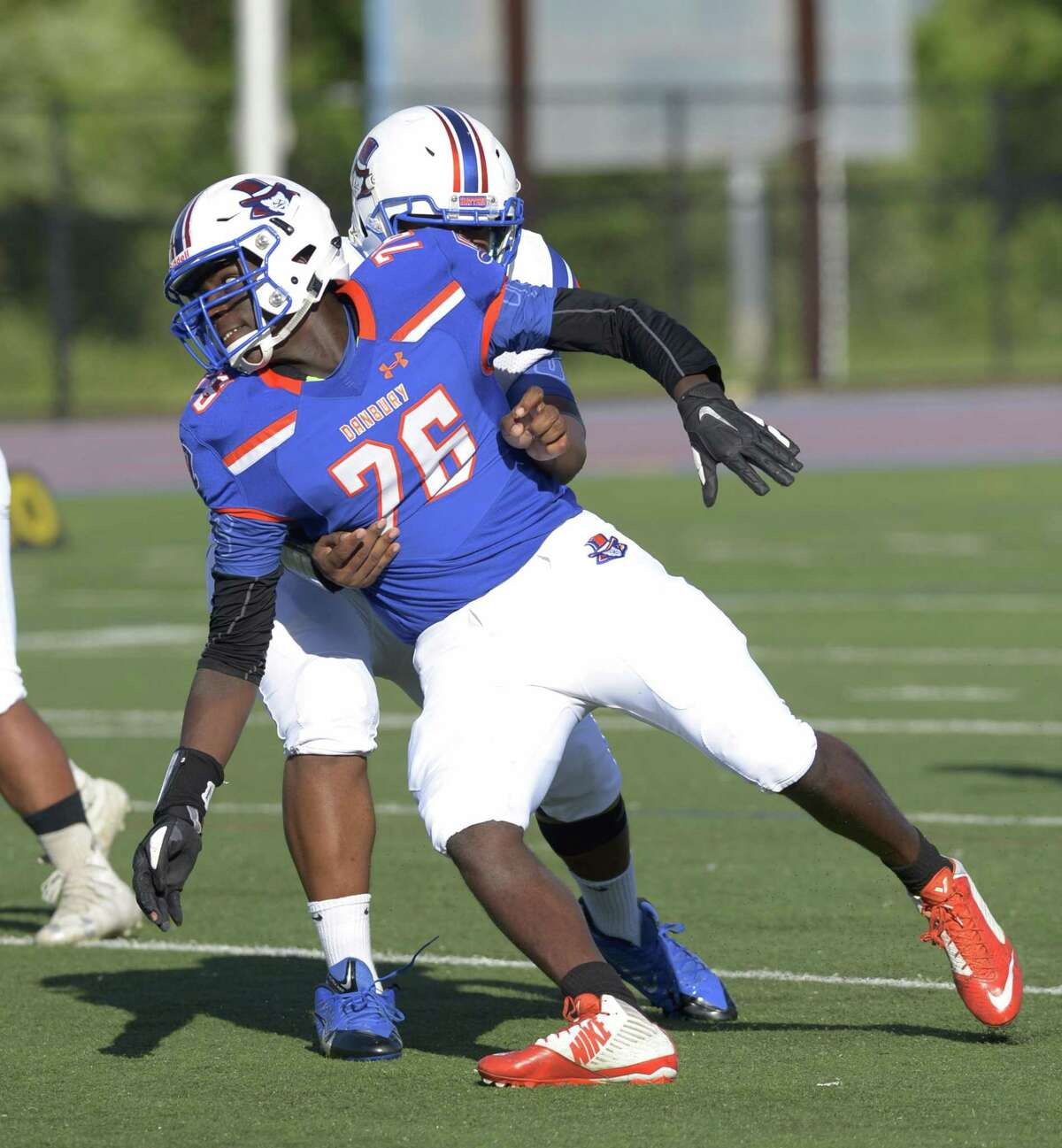 Danbury High School's Jah Joyner plays in the schools Blue & White spring football game on Friday night. June 14, 2019, at Danbury High School, Danbury, Conn. Defensive end Joyner recently committed to play at Boston College.