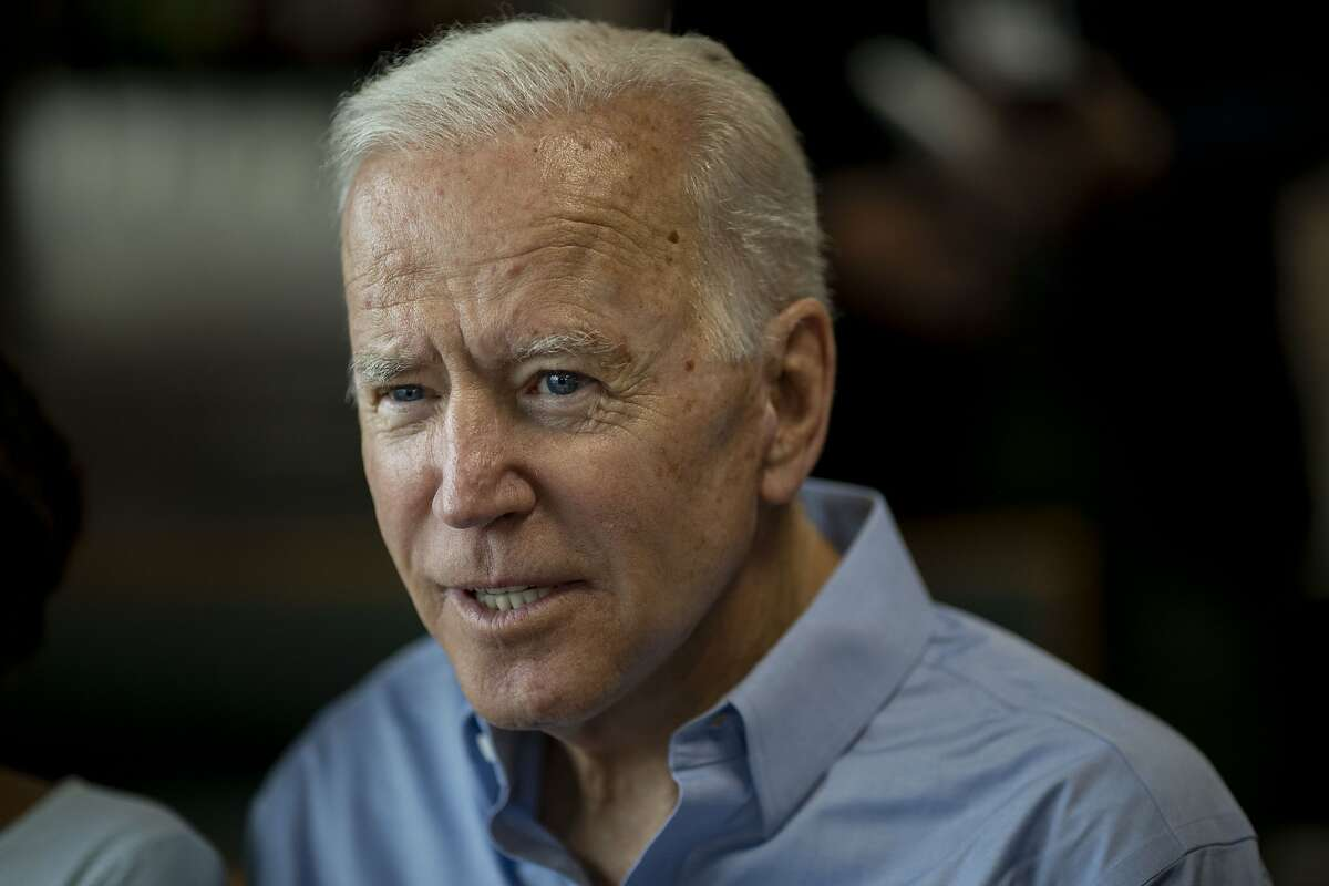 Former U.S. Vice President Joe Biden, 2020 Democratic presidential candidate, speaks with patrons during a campaign stop in Eldridge, Iowa, U.S., on Wednesday, June 12, 2019.