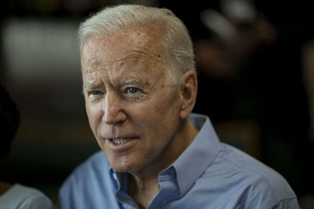Former U.S. Vice President Joe Biden, 2020 Democratic presidential candidate, speaks with patrons during a campaign stop in Eldridge, Iowa, U.S., on Wednesday, June 12, 2019. Biden expressed concern about the format of the first Democratic presidential debates, saying that having 20 candidates face off over two nights means there will be little depth to the events. Photographer: Daniel Acker/Bloomberg