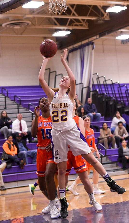 Westhill's Grace Hansen (22) shoots against Danbury's Tanisha Cunningham (15) during an FCIAC girls basketball game at Westhill High School in Stamford on Jan. 11, 2018. Hansen will forego basketball and soccer, but will play lacrosse at UMass-Lowell in the fall. Photo: Matthew Brown / Hearst Connecticut Media / Stamford Advocate