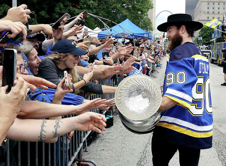 Blues center Ryan O'Reilly carries the Stanley Cup during the team's Stanley Cup victory celebration Saturday in St. Louis. Photo: Darron Cummings | AP Photo