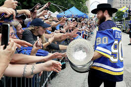 Blues center Ryan O'Reilly carries the Stanley Cup during the team's Stanley Cup victory celebration Saturday in St. Louis.
