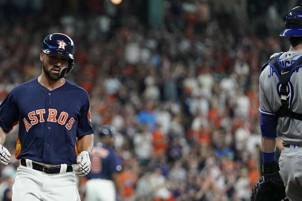 Houston Astros Jack Mayfield crosses the plate on a double hit by Myles Straw against the Totonto Blue Jays during the fourth inning at Minute Maid Park Saturday, June 15, 2019, in Houston.