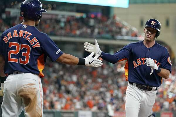 Houston Astros Michael Brantley (23) celebrates with Myles Straw after he scored against the Toronto Blue Jays during the fourth inning at Minute Maid Park Saturday, June 15, 2019, in Houston. Myles Straw scored on the hit by Alex Bregman.