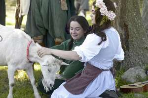 """Kaza Ayersman, of Meridian as the character """"Fifel Featherbottom"""" and Momo O'Brien, of Toronto, Canada, as the character """"Briar of Ridden-helm"""" attended the Goat LARP hosted by Farm Jibe-IT on Saturday. The event is live action role playing for goats, where people wore costumes and included the goats in their stories. June 15, 2019, in Redding, Conn."""