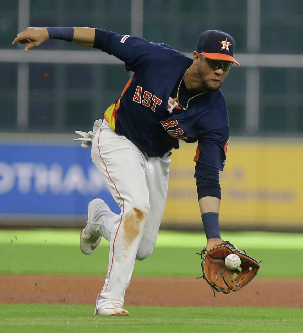Houston Astros Yuli Gurriel scoops up a ground out hit by Toronto Blue Jays Lourdes Gurriel Jr. during the third inning at Minute Maid Park Saturday, June 15, 2019, in Houston.