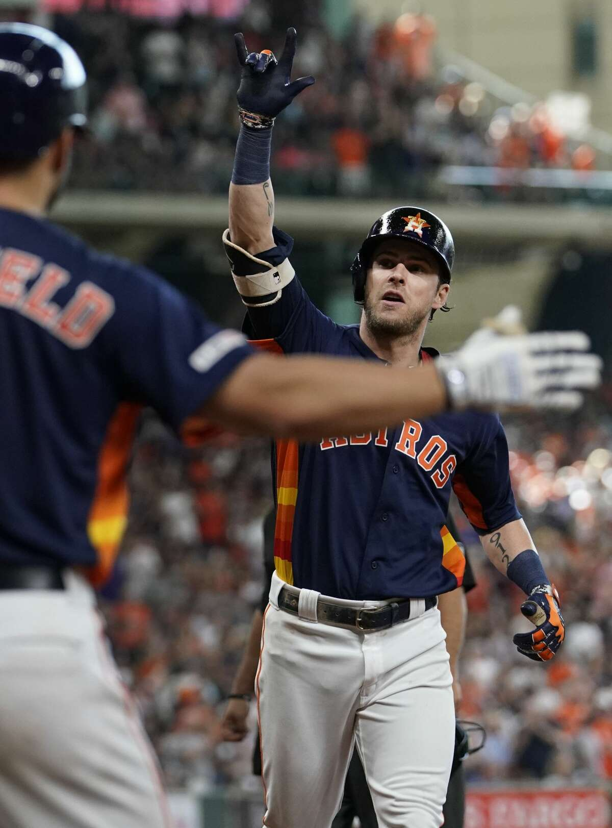 Houston Astros Jack Mayfield, left, celebrates home run hit by Josh Reddick against the Toronto Blue Jays during the sixth inning at Minute Maid Park Saturday, June 15, 2019, in Houston.