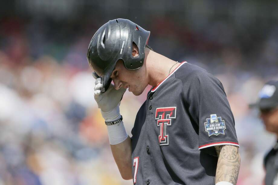 Texas Tech's Cody Masters (7) reacts after being thrown out at first by Michigan pitcher Karl Kauffmann in the sixth inning of an NCAA College World Series baseball game in Omaha, Neb., Saturday, June 15, 2019. Michigan won 5-3. (AP Photo/Nati Harnik) Photo: Nati Harnik/Associated Press