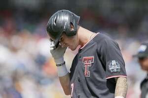 Texas Tech's Cody Masters (7) reacts after being thrown out at first by Michigan pitcher Karl Kauffmann in the sixth inning of an NCAA College World Series baseball game in Omaha, Neb., Saturday, June 15, 2019. Michigan won 5-3. (AP Photo/Nati Harnik)