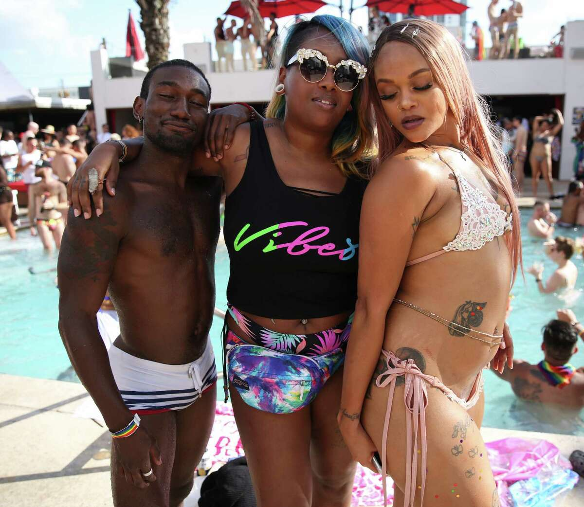 People pose for photos at the Baewatch x Salvation 2019 Official Pride Pool Party in Houston, Saturday, June 15, 2019.