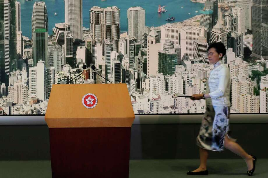 Hong Kong's Chief Executive Carrie Lam arrives at a press conference in Hong Kong Saturday, June 15, 2019. Lam said she will suspend a proposed extradition bill indefinitely in response to widespread public unhappiness over the measure, which would enable authorities to send some suspects to stand trial in mainland courts. (AP Photo/Kin Cheung) Photo: Kin Cheung / Copyright 2019 The Associated Press. All rights reserved.