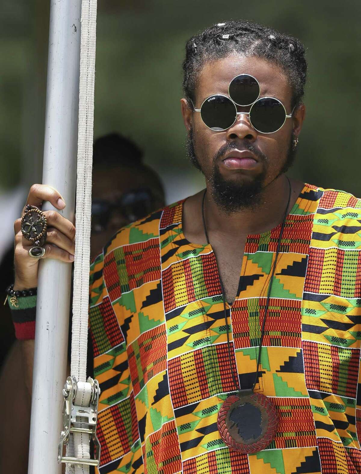 Darryal Smith, of Louisiana, watches a live performance at the 147th annual Juneteenth Celebration at Emancipation Park on Saturday, June 15, 2019, in Houston.