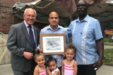 Kelsey Collins, center, was honored as father of the year at the Juneteenth celebration in Schenectady's Central Park Saturday. He is joined by Congressman Paul Tonko, left; Ron Gardner, right; and his daughters, Kyrie, Kiani and Kiara Collins.