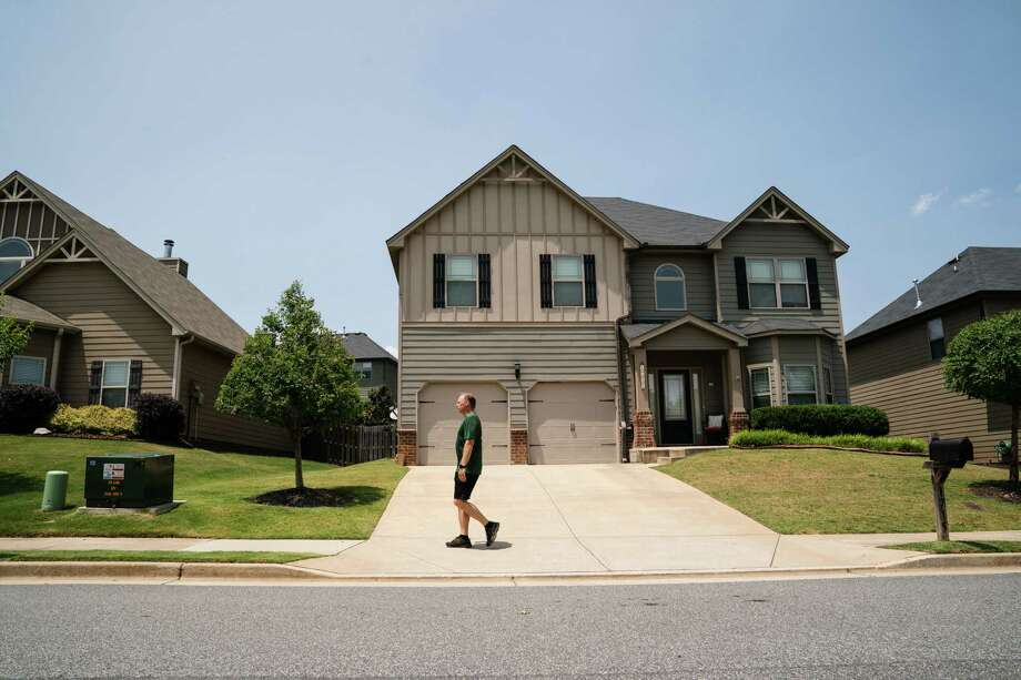 Mickey Norris, HOA president of Saddlebrook subdivision, walks through his neighborhood, an outgrowth of Atlanta's sprawl along State Route 400. Photo: Photo For The Washington Post By Kevin D. Liles / Kevin D. Liles