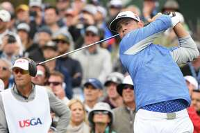 Gary Woodland of the United States plays a shot from the 13th tee during the third round of the 2019 U.S. Open at Pebble Beach Golf Links on June 15, 2019 in Pebble Beach, California.
