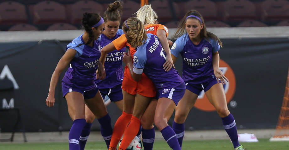 The ball is stripped from Houston Dash midfielder Kristie Mewis (19) as four Orlando Pride players are defending her during the first half of the NWSL game at BBVA Stadium on Saturday, June 15, 2019, in Houston. Photo: Yi-Chin Lee/Staff Photographer / © 2019 Houston Chronicle