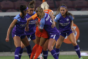The ball is stripped from Houston Dash midfielder Kristie Mewis (19) as four Orlando Pride players are defending her during the first half of the NWSL game at BBVA Stadium on Saturday, June 15, 2019, in Houston.