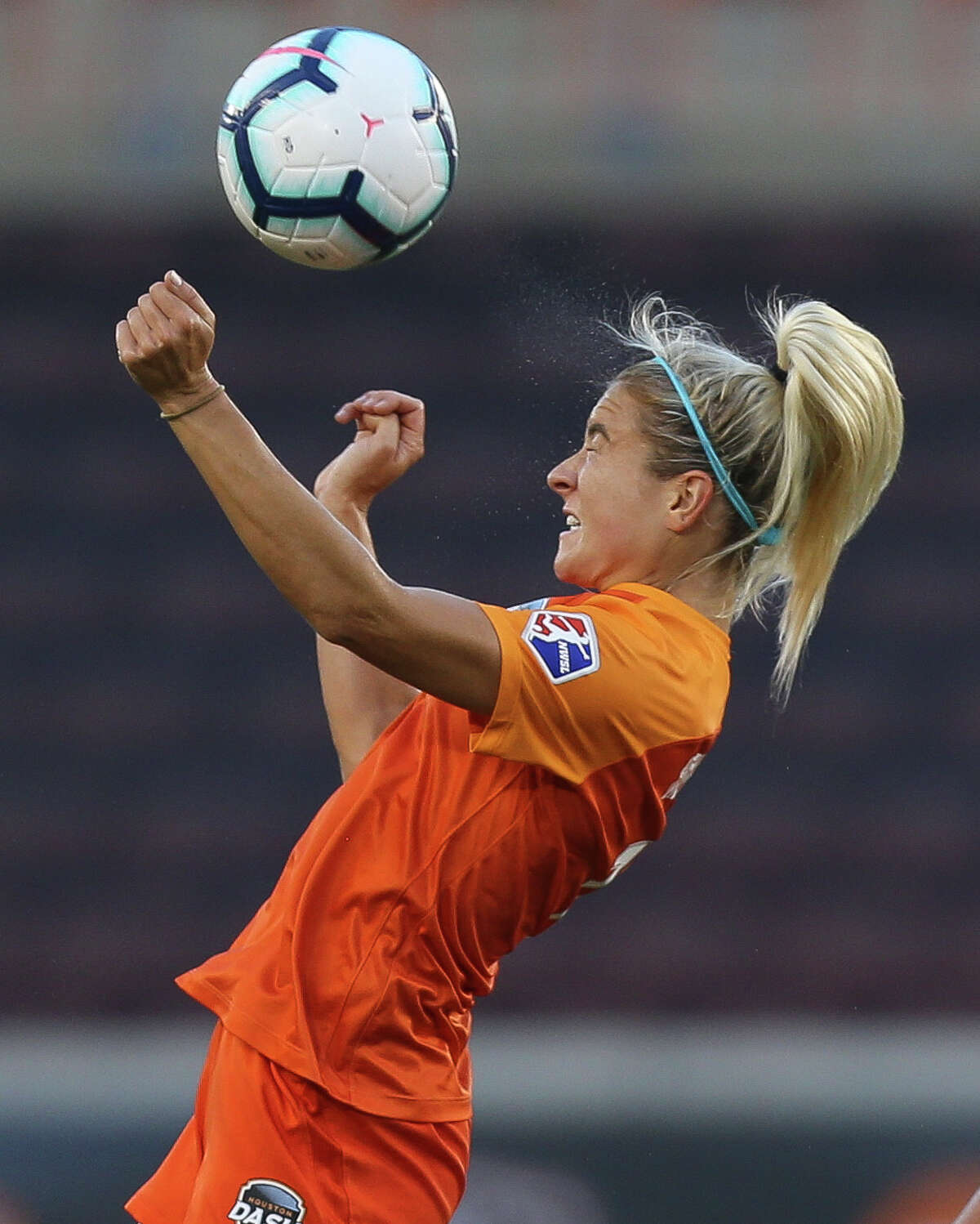 Houston Dash midfielder Kristie Mewis (19) goes up for a header during the first half of the NWSL game at BBVA Stadium on Saturday, June 15, 2019, in Houston.