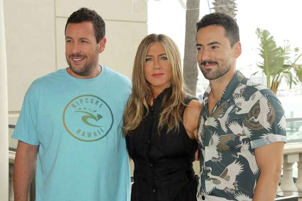 """Adam Sandler, from left, Jennifer Aniston and Luis Gerardo Mendez attend the """"Murder Mystery"""" photo call at the Ritz-Carlton Marina del Rey on Tuesday, June 11, 2019, in Los Angeles. (Photo by Willy Sanjuan/Invision/AP)"""
