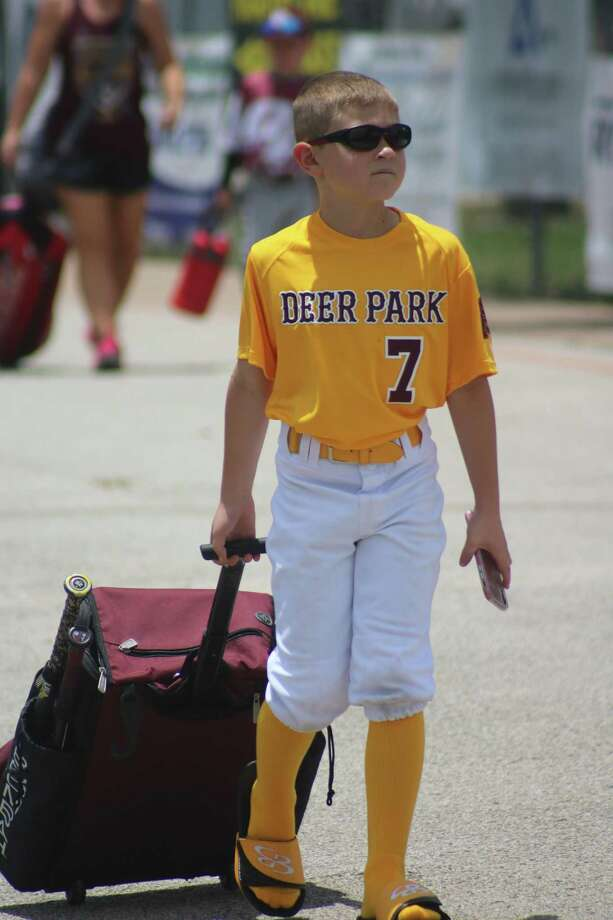In his flip-flops, Deer Park Pinto 8U all-star Beckett Holbrook enters Renwick Park Saturday. Standing by the mound for this coach pitch league, Beckett did a good job of barking out how many outs there were and where to go with the throw during the team's 9-6 win over Friendswood. Photo: Robert Avery