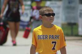 In his flip-flops, Deer Park Pinto 8U all-star Beckett Holbrook enters Renwick Park Saturday. Standing by the mound for this coach pitch league, Beckett did a good job of barking out how many outs there were and where to go with the throw during the team's 9-6 win over Friendswood.