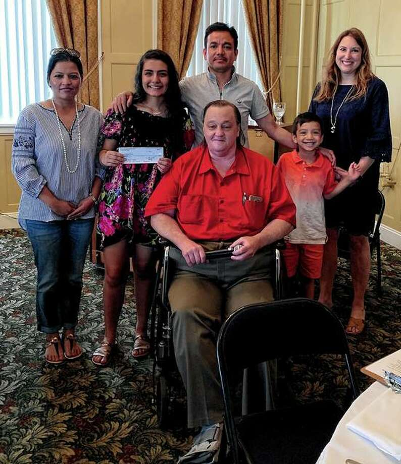 Roger Deem (front) of the Jacksonville Kiwanis Club presents the Bill Deem Science Award to Sadikshya Ghimire (second from left) during a recent Kiwanis meeting. Ghimire was accompanied by her family and Heather English (right), chair of Jacksonville High School's science department. Photo: Photo Provided