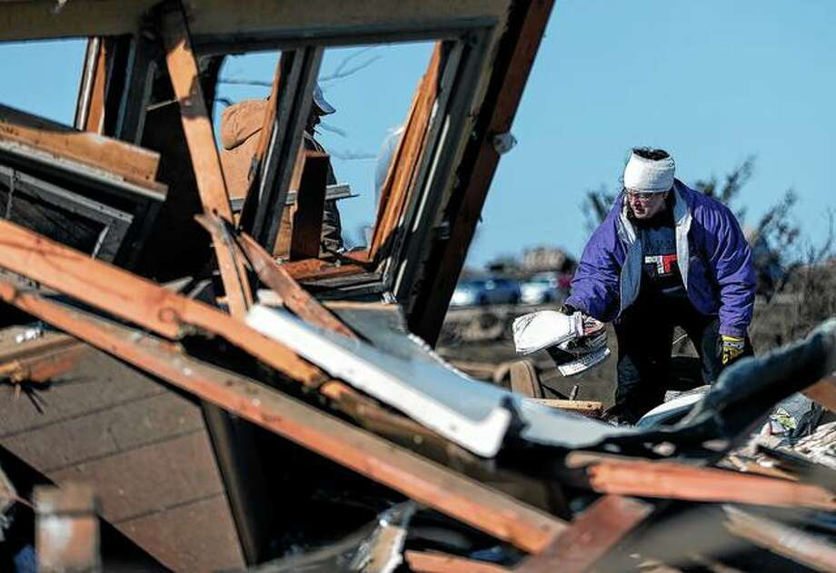 Candy Trudell searches for her belongings in the rubble after a tornado struck the town of Rochelle in Illinois in April 2015. Photo: Ting Shen | NurPhoto (Getty Images)