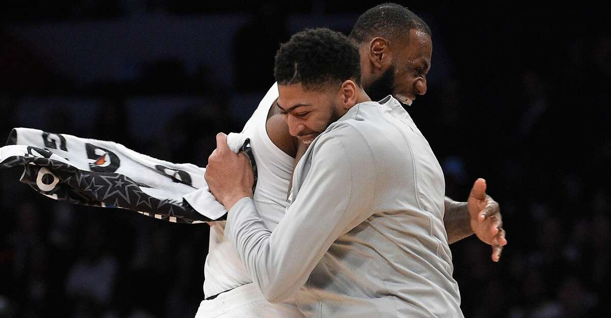 FILE - JUNE 15: The Los Angeles Lakers have traded Lonzo Ball, Brandon Ingram, Josh Hart and three first-round picks to the New Orleans Pelicans for star Anthony Davis on June 15, 2019. LOS ANGELES, CA - FEBRUARY 18: LeBron James #23 of Team LeBron celebrates with teammate Anthony Davis #23 after the end of the NBA All-Star Game 2018 at Staples Center on February 18, 2018 in Los Angeles, California. Team LeBron won the game 148-145. (Photo by Kevork Djansezian/Getty Images)