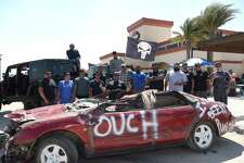 Laredo Harley-Davidson and the members of the Jeep Punishment Jeep Club come together to celebrate fathers around the city with food, music and some vehicular carnage in the form of car crushing on Saturday.