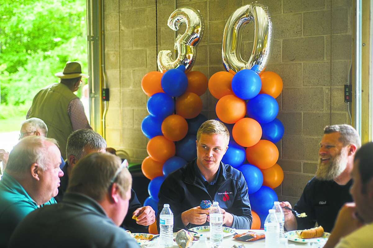 Guests enjoy lunch during a 30th anniversary celebration for the Great Lakes Safety Training Center on Wednesday, June 12, 2019 at the facility in Midland. (Katy Kildee/kkildee@mdn.net)