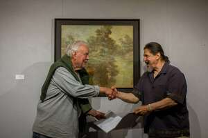 "Gino Zenobia, show chair for the Kent Art Association, presents the The Ridgewood Art Association's Award of Excellence to Werner Kappes, of New Preston for his Oil painting titled ""Twilight"""