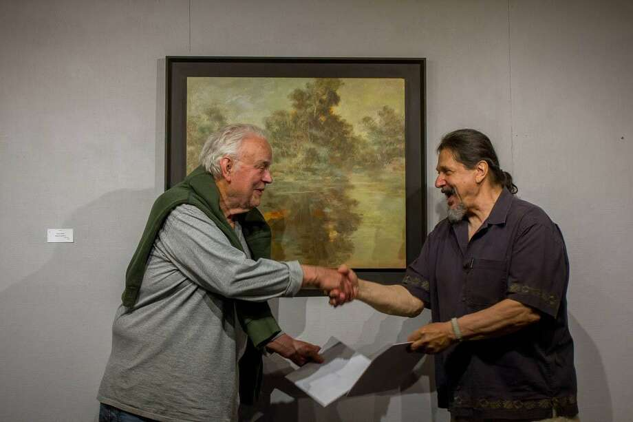 "Gino Zenobia, show chair for the Kent Art Association, presents the The Ridgewood Art Association's Award of Excellence to Werner Kappes, of New Preston for his Oil painting titled ""Twilight"" Photo: Contributed Photo / Contributed / The News-Times Contributed"