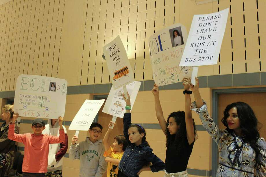 Students and parents of Eagle Hill School, a private school in Greenwich for children with language-based learning differences, protest a decision by the Greenwich Public Schools to cease bus transportation for these students. The protest was held at Thursday's meeting of the Board of Education at Cos Cob School. Photo: Jo Kroeker / Hearst Connecticut Media /