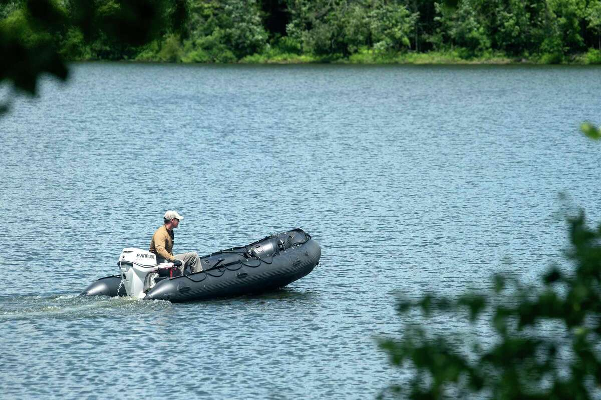 The Connecticut State Police dive team searched the pond at Fisher Meadows Recreation Area in Avon three weeks after Jennifer Dulos vanished.