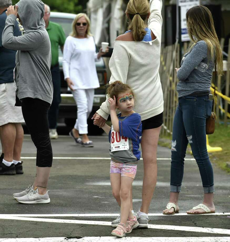 Branford, Connecticut - Sunday, June 16, 2019: Kendall Kaminsky, 5, of Branford, standing behind his grandmother Karen Gallo of Guilford, waits for the start of the Branford Road Race and Fun Run during the Branford Festival Sunday in Branford. Photo: Peter Hvizdak / Hearst Connecticut Media / New Haven Register