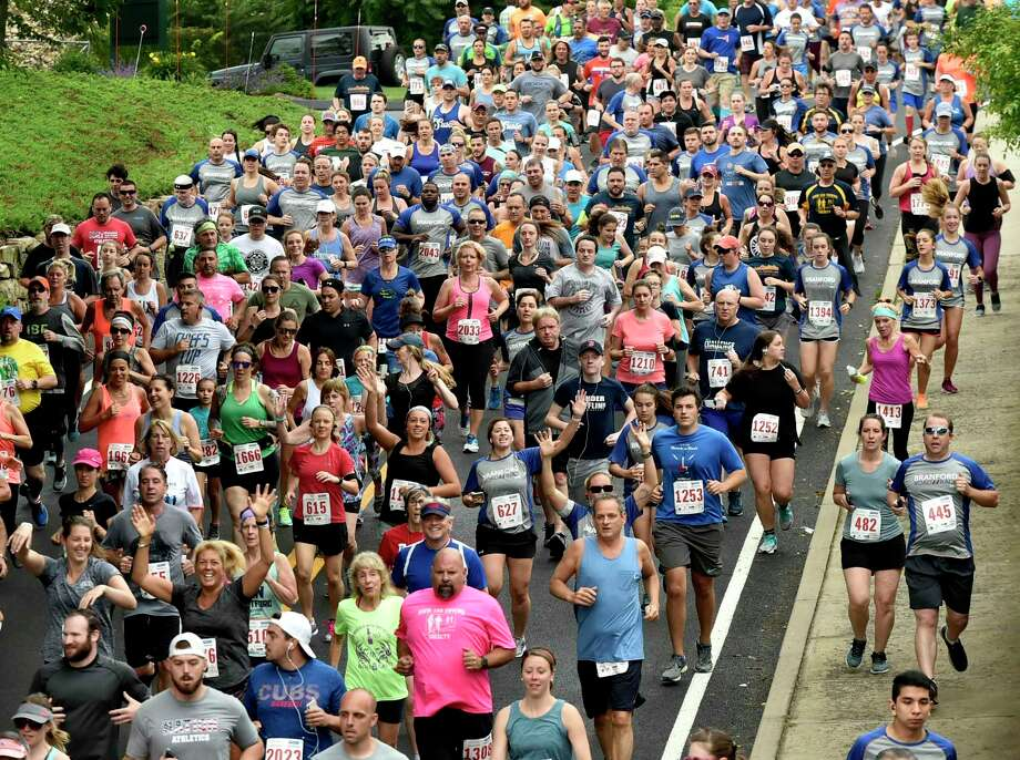 Runners funnel down South Montowese Street during the 5K Branford Road Race at the 2019 Branford Festival. Photo: Peter Hvizdak / Hearst Connecticut Media File / New Haven Register