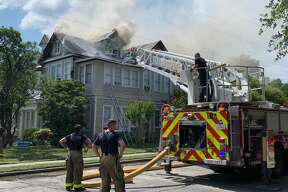 San Antonio firefighters battle an apartment fire Sunday afternoon, Sunday, June 16, 2019, in central San Antonio on the 300 block of Magnolia Avenue.