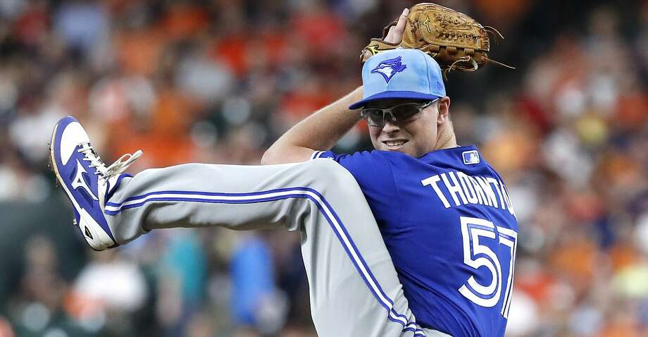 Toronto Blue Jays starting pitcher Trent Thornton (57) pitches during the first inning of an MLB baseball game at Minute Maid Park, Sunday, June 16, 2019. Photo: Karen Warren/Staff Photographer