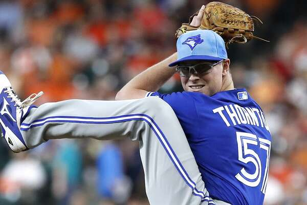 Toronto Blue Jays starting pitcher Trent Thornton (57) pitches during the first inning of an MLB baseball game at Minute Maid Park, Sunday, June 16, 2019.